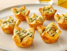 Here's an innovative appetizer that uses Puff Pastry, potato flakes, French fried onions and Cheddar cheese to make bite-sized pastries with big-time flavor. Ready to serve during the next big game or St. Patrick's Day party. Unfold one Puff Pastry sheet, cut into 36 squares, and press into a mini muffin tin. Fill each tartlet with a mixture of potato flakes, sour cream, cheese, French fried onions, chives, and garlic powder. After 15 minutes in the oven, you've got a mouth-watering…