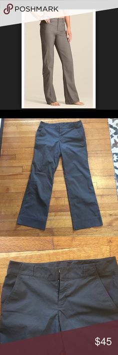 Athleta Petite Lightweight Cargo Pants Athleta Petite lightweight cargo pants in a sand / brown color. 95% nylon 5% spandex. Style 689541. Features two zip pockets on back, two front hand pockets, one zip cargo pocket, belt loops, zip fly. In excellent condition. Athleta Pants Track Pants & Joggers