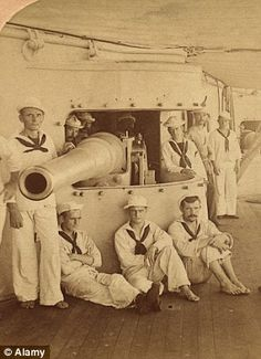 US gun crew, 1898, on USS Olympia. The cruiser was in service from 1895-1922. It is most famous as the vessel commanded by Commodore George Dewey in 1898 at the Battle of Manila Bay during the Spanish-American War.  'You may fire when you are ready, Gridley,' was famously uttered by Dewey during the battle which saw the Spanish bombarded into defeat.