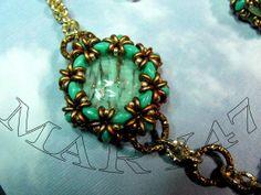 collana con perle veneziane incastonate  e chianmaille