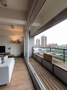 Balcony narrow and long with wooden bench and decorated with cushions