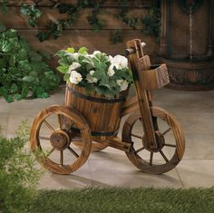 This may be the most charming plant holder ever! The rain barrel potted plant holder features authentic black metal banding and is set on a wooden tricycle fram