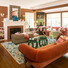 Apricot velvet and a creative floor plan make this living room a dream. Love the conversation zones in this design.