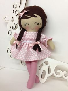 "This is a 15"" Doll that is part of the Lil' Miss Fancy Pants Doll collection from Sew Many Pretties.  This cutie is handmade from 100% cotton fabrics and wool blend felt for her hair.  Facial features are hand embroidered.  Her skirt has a velcro closure that makes it easy for a young child t..."