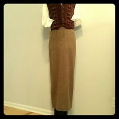 """Ralph Lauren Brown Tweed Maxi Skirt NWOT Elegant, brown, barleycorn tweed maxi sheath skirt by Ralph Lauren has satin lining and split open hem in back, zip, clasp and button closure in front. Slim, straight, fitted at waist with pleats, and banded waist, lower-calf length at 36"""" long.  Never worn. Ralph Lauren Skirts Maxi"""