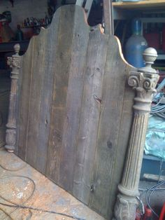 Rustic headboard.  Just your average barn boards and stair newel,s cut in half.