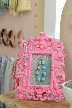 Add an additional spot to hang your jewelry on by placing a Command™ Clear Decorating Clip inside of a fun, bright colored picture frame!