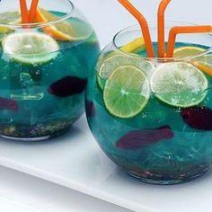 ADULT fish Bowl punch - Vodka, coconut rum, Blue Curacao, sweet Sour, pineapple juice, lemon-lime soda