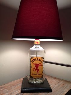 Fireball Whiskey Bottle Lamp with Red Shade Fireball Whiskey, Whiskey Bottle, Old Liquor Bottles, Mystery Of Light, Bottle Lights, Bottle Lamps, Wine Bottle Crafts, Do It Yourself Projects