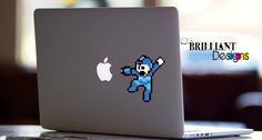 """Color """"8 Bit Mega Man"""" Decal      This die cut vinyl decal is for the Macbook Pro, Macbook Air or Macbook with Retina display. Actually you can put it on anything if you want This die cut vinyl decal will give your laptop a touch of individuality and make your device unique, while still showing off the lines and finish of your Macbook.     This vinyl decal is for the Macbook Pro, Macbook Air or Macbook with Retina display, Actually you can put it on anything if you want.         Made in the…"""