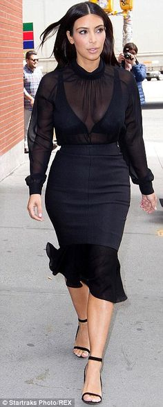 Too much going on: Kim's Kardashian outfits can border on the ridiculous, and this one goes there