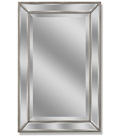 The individual prism beveled mirror is bordered with dainty, colored beading and emitting an elegant feminine flair. The edges are finished in a matching finish. It can be used in traditional, modern or eclectic settings. This timeless creation complements common bath decor as well as entryways. The use of multiple mirrored parts reflect extra light to other areas of the room. With a finished back this mirror can hang horizontally or vertically.