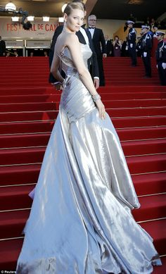 Simply stunning: Uma Thurman shows she really is a Hollywood goddess in her floor-length satin gown