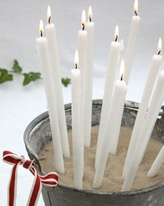 Easy Christmas Decor - stand candles in a sand filled container! Awesome! Add decorations, change candle color as you wish.