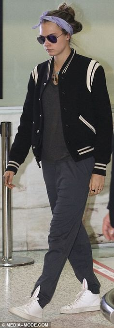Covering up: The 22-year-old braved the cool Sydney weather with a black baseball-styled jacket
