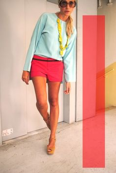 Love the shorts and top color combination. Would prefer a chunky green necklace instead.