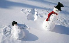Cute. Snowman making snow angel.