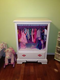 Turn an old broke down dresser into an awesome dress up closet! Im so doing this!