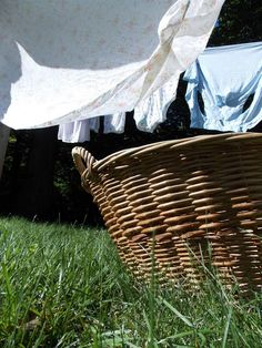 Laundry on the line & wicker laundry baskets in the grass - Delightful Handwork