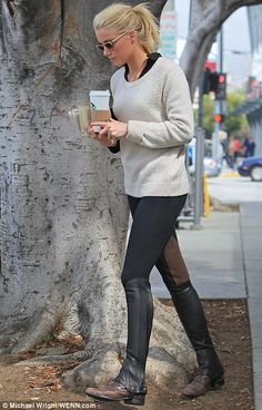 Amber Heard all equestrian chic wearing boots and half chaps in Los Angeles