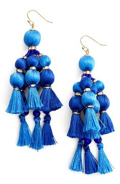 Pretty, pretty pom poms. These elegant drop earrings show off the vibrant colors of summer.