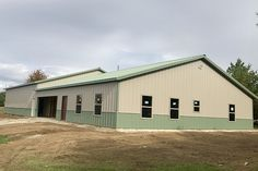 Lester Buildings Post-Frame House and Shop. 4/12 roof pitch, wainscot, sliding door. House is 50' x 50' x 9' high; shop is 50' x 50' x 12' high. #residential #home #house #shop #hobbyshop #storage #polebarn #postframe #postframehome