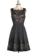Tonight's all about you - step to the stage in this sleeveless lace dress and woo your admirers with your words! A wide neckline, accented by scallops, frames your face as you read an excerpt, then curtsey and extend the A-line skirt of this black frock to thunderous applause.