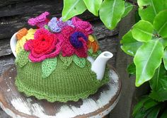 Knitted tea cozy with crocheted flowers. If you don't crochet, then substitute knitted flowers. Now I'll have to get that china teapot and brew tea.