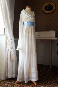 """Herschel Museum in Bath, England. Dress worn by Caroline Herschel, in a simple style of white muslin with a blue spot. Its high waist and design of the sleeves date it to the closing years of the 18th century, so Caroline would have been about 50 when she wore it. You can't tell in this photo, but it is quite small for a mature woman. Caroline was always small due to severe childhood illnesses. Mona Evans, """"Herschel Museum of Astronomy"""" http://www.bellaonline.com/articles/art48626.asp"""