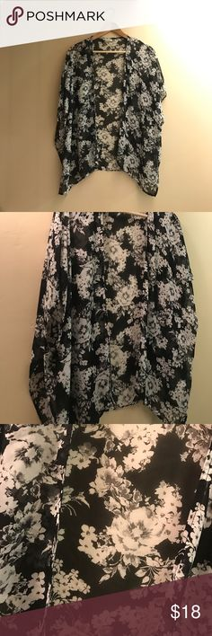 """Floral kimono 🚨Add your likes to a bundle for a private deal🚨.    Black and white floral kimono. Perfect condition. No flaws. Brand is """"Poetry"""", size is medium. If you have any questions feel free to ask 😊 item comes from a smoke/pet free home Poetry Sweaters Cardigans"""