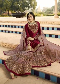 Maroon Ethic Embroidered Pakistani Gharara Suit features a beautiful designer satin georgette top with delicate traditional embroidery with zari and resham machine work that goes amazingly with the. Pakistani Gharara, Pakistani Formal Dresses, Pakistani Wedding Outfits, Indian Gowns Dresses, Pakistani Wedding Dresses, Pakistani Dress Design, Bridal Outfits, Red Gowns, Pakistani Actress