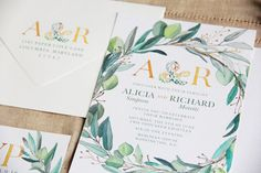 These Leafy Wreath Monogram Wedding Invitations use beautiful watercolor elements for a high end look