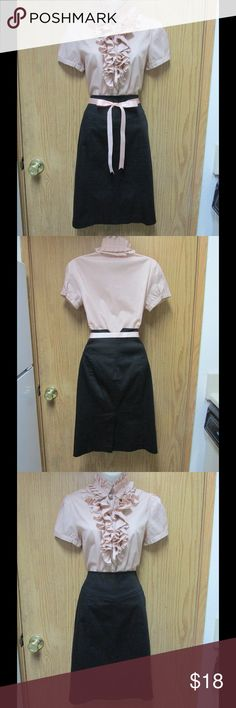Elegant Black Skirt W/V-Design on the Back & Belt This skirt is perfect for work or important events. Super soft and comfy. Beautiful design. Belt included. Size Medium 8 - Almost New. Save $$$ on bundles. Skirts Midi
