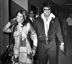 Elvis and Priscilla when they signed for their divorce.