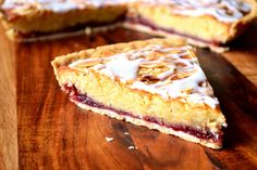 Cherry Bakewell Tart - a classic British tart with a storied history, flavoured with delicious cherry jam and a delicate almond-infused frangipane sponge. Cherry Bakewell Recipe, Bakewell Pudding, Bakewell Tart, Tart Recipes, Sweet Recipes, Baking Recipes, Dessert Recipes, Sweet Pie, Sweet Tarts