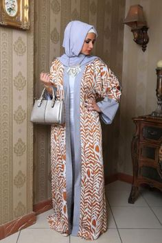 Gorgeous abaya in silver and orange, perfect for many special events.