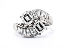 Maple Hill is an Art Deco ring with curving diamonds in an elegant dance surrounded by ten bright white graduating straight baguette diamonds. TrumpetandHorn.com | $12,500