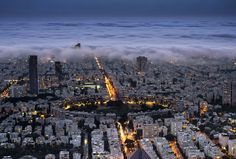 A view of Tel Aviv as night settles over Kikar HaMedina