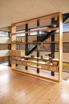 fabulous wooden shelves divider wall ideas beside dark wooden stairs interior also wooden floor and wide glass window in the nearby