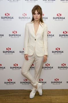 Suki Waterhouse in a cream colored suit & Superga sneakers.