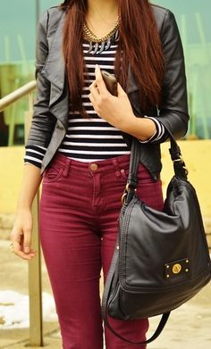 Burgundy jeans with a striped shirt.