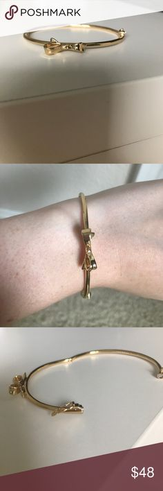 Kate Spade Gold Bow Bracelet with Magnetic Close Kate Spade Gold Bow Bracelet with Magnetic Close and Catch. Perfect condition. Never worn. Feel free to make an offer! kate spade Jewelry Bracelets