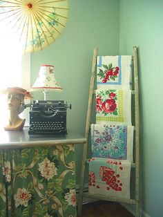 Love this idea for showing off my collection of vintage linens. Now to find a ladder....