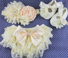 In this pic I like the booties the most. Quite simple with white flowers. ************  ♛ The diaper cover is in a rich coral and creamy - ivory, made from soft stretch cotton and rows of ivory lace. The front has no lace ruffle.  ♛ Perfect