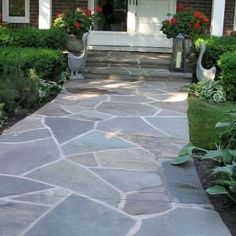 70 Beautiful Front Yard Pathway Landscaping Ideas Your home is your pride and joy, and you want it to look great from inside and out. The very first thing people see when they drive past, or up to your home, is your front yard and entr Flagstone Pathway, Paver Walkway, Walkway Ideas, Stone Walkways, Slate Walkway, Stamped Concrete Walkway, Backyard Walkway, Slate Patio, Sloped Backyard