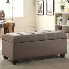 This modern button-tufted storage bench features a fabulous linen upholstery in rich grey for a neutral element that will complement any decor. Perfect for adding storage and seating to any room, stow away your extra blankets, pillow and more.