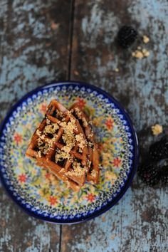Delicious Blueberry Buckle Waffle Recipe.  Introducing the blueberry buckle waffle recipe.  It's not complicated, just my favorite waffle recipe with the addition of some blueberries and topped with a crumble mixture on top of the syrup.