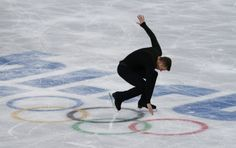 Jeremy Abbott of the U.S. competes during the Figure Skating Men's Free Skating Program at the Sochi 2014 Winter Olympics