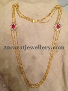Simple and light weight gundla haram with three strings of gold beads chains attached to tear drop shaped motifs on either side studded with central ruby and surrounded by shining CZ stones. Light Weight Gold Jewellery, Gold Jewelry Simple, Gold Chain Design, Gold Jewellery Design, Designer Jewellery, Gold Earrings Designs, Necklace Designs, Schmuck Design, Indian Jewelry