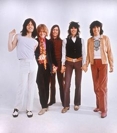 The Rolling Stones wanna hold your hand (or each other's anyway), 1969, by Ethan Russell